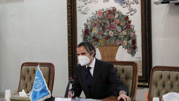 International Atomic Energy Agency (IAEA) Director General Rafael Grossi wears a mask during a meeting with head of Iran's Atomic Energy Organization Ali-Akbar Salehi, in Tehran, Iran February 21, 2021.  - Sputnik International