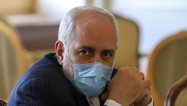 Iran's Foreign Minister Mohammad Javad Zarif looks on during a meeting with International Atomic Energy Agency (IAEA) Director General Rafael Grossi in Tehran, Iran February 21, 2021. - Sputnik International