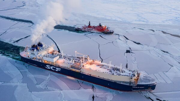Sovcomflot LNG ship Christophe de Margerie and Russian icebreaker 50 Let Pobedy traverse the Northern Sea Route in February 2021, the first commercial cargo vessel to do so - Sputnik International