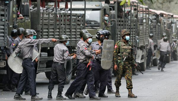 Police and soldiers are seen during a protests against the military coup, in Mandalay, Myanmar, February 20, 2021 - Sputnik International
