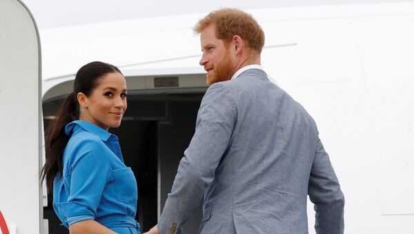 Britain's Prince Harry and Meghan, Duchess of Sussex look on before departing from Fua'amotu International Airport in Tonga October 26, 2018 - Sputnik International