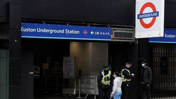 British Transport Police officers check on travellers as they arrive at Euston rail station during lockdown restrictions, amid the spread of the coronavirus disease (COVID-19) pandemic, London, Britain, January 31, 2021.  - Sputnik International