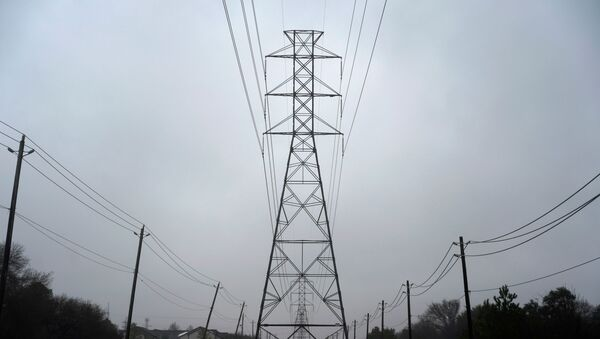 Power lines are seen after winter weather caused electricity blackouts in Houston, Texas, U.S. February 17, 2021 - Sputnik International