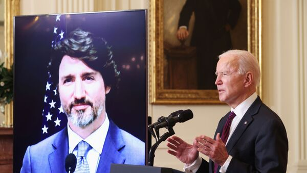 U.S. President Joe Biden and Canada's Prime Minister Justin Trudeau, appearing via video conference call, give closing remarks at the end of their virtual bilateral meeting from the White House in Washington, U.S. February 23, 2021 - Sputnik International