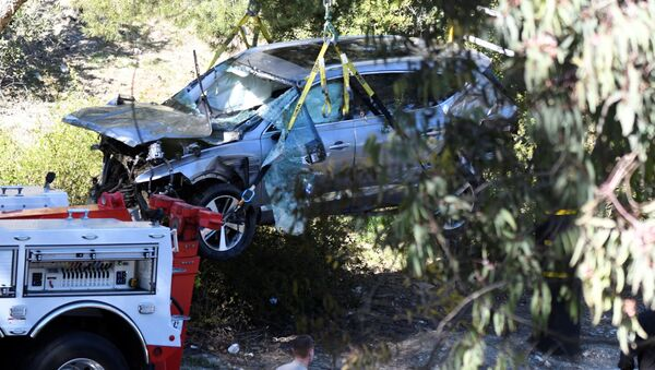 The vehicle of golf legend Tiger Woods, who was rushed to hospital after suffering multiple injuries, is lifted by a crane after being involved in a single-vehicle accident in Los Angeles, California, US, 23 February 2021. - Sputnik International