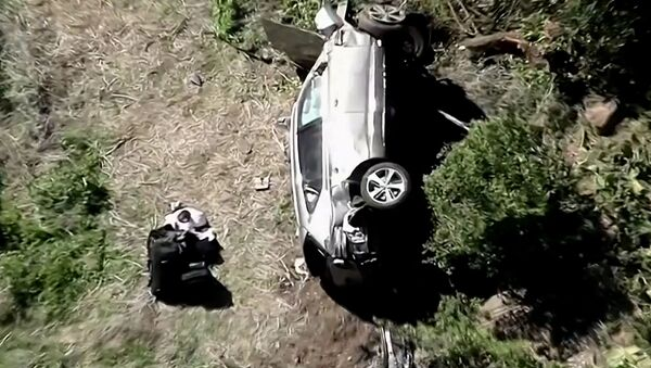 The vehicle of golfer Tiger Woods, who was rushed to hospital after suffering multiple injuries, lies on its side after being involved in a single-vehicle accident in Los Angeles, California, U.S. in a still image from video taken February 23, 2021 - Sputnik International