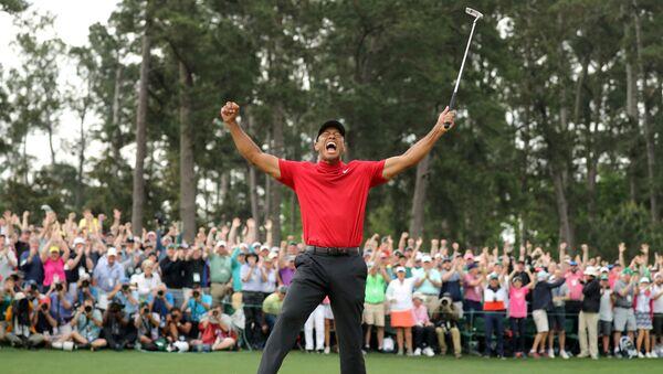 FILE PHOTO: Golf - Masters - Augusta National Golf Club - Augusta, Georgia, U.S. - April 14, 2019. Tiger Woods of the U.S. celebrates on the 18th hole to win the 2019 Masters. - Sputnik International