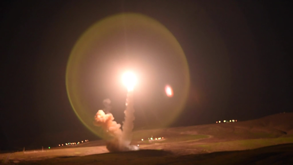 A US Minuteman III intercontinental ballistic missile is test-fired from Vandenberg Air Force Base in California toward a missile range in Kwajalein Atoll in the Marshall Islands, 4,200 miles away, on February 23, 2021 - Sputnik International