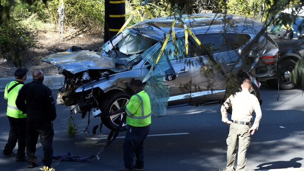 The vehicle of golfer Tiger Woods, who was rushed to hospital after suffering multiple injuries, is lifted by a crane after being involved in a single-vehicle accident in Los Angeles, California, U.S. February 23, 2021. - Sputnik International