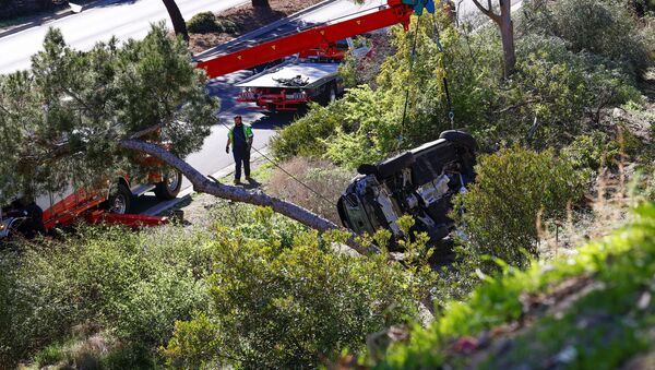 The overturned car of Tiger Woods is seen after he was involved in a car crash, near Los Angeles, California, U.S., February 23, 2021. REUTERS/Mario Anzuoni - Sputnik International