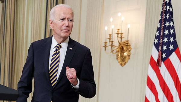 U.S. President Joe Biden listens to a question after delivering remarks and prior to signing an executive order, aimed at addressing a global semiconductor chip shortage, in the State Dining Room at the White House in Washington, U.S., February 24, 2021 - Sputnik International