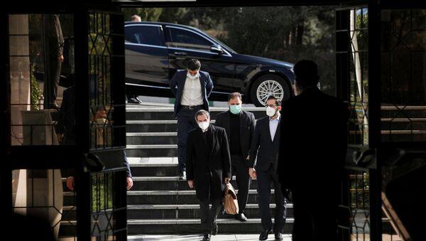 International Atomic Energy Agency (IAEA) Director General Rafael Grossi walks during a meeting with the head of Iran's Atomic Energy Organisation Ali-Akbar Salehi, in Tehran, Iran, 21 February 2021 - Sputnik International