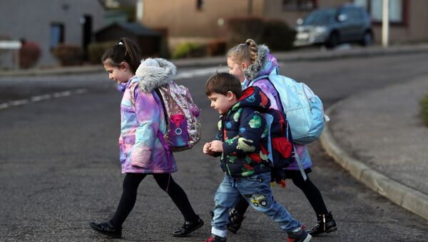 Pupils walk to Pitlochry High School on the first day back following the easing of the coronavirus disease (COVID-19) restrictions, in Pitlochry, Scotland, Britain, February 22, 2021. - Sputnik International