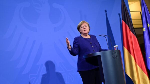 German Chancellor Angela Merkel addresses a press conference following the EU leaders' videoconference in Berlin, Germany February 25, 2021. - Sputnik International