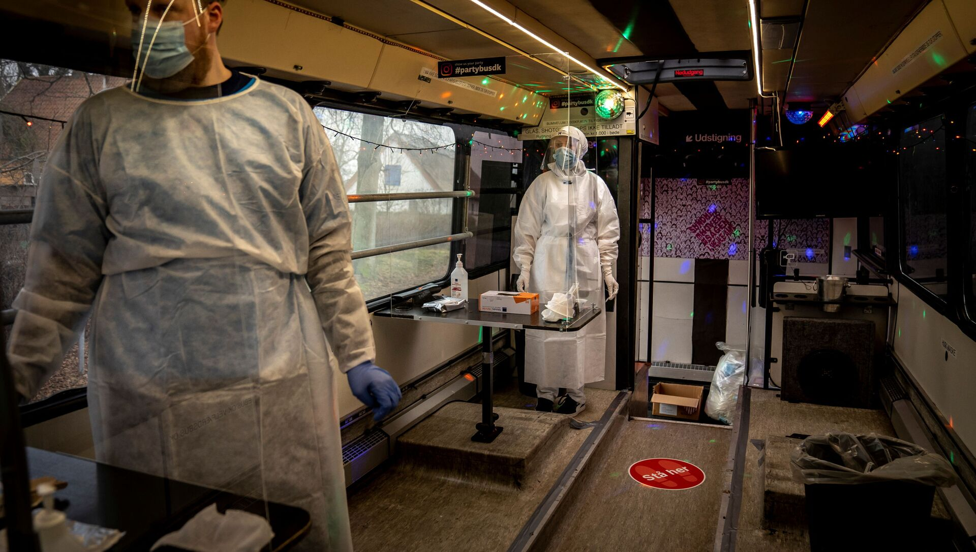 Healthcare workers wait in the Partybus, where people can listen to music while being tested for the coronavirus disease (COVID-19), in Ishoej, Denmark February 23, 2021 - Sputnik International, 1920, 27.07.2021