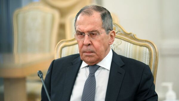 Russian Foreign Minister Sergei Lavrov during a meeting with his Afghan counterpart Mohammad Hanif Atmar on Friday, February 26, 2021. - Sputnik International