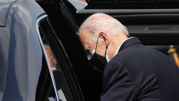 U.S. President Joe Biden gets into the car upon arrival at Ellington Field Joint Reserve Base in Houston, Texas, U.S., February 26, 2021. - Sputnik International