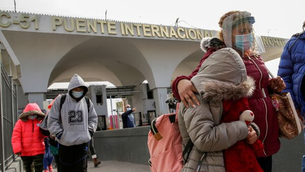 Migrants from Central America, under the Migrant Protection Protocols (MPP) programme, walk across the Paso del Norte international border bridge from the Mexican side to continue their asylum request in the United States, in Ciudad Juarez, Mexico 26 February 2021.  - Sputnik International