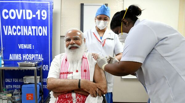 India's Prime Minister Narendra Modi receives a dose of COVAXIN, a coronavirus disease (COVID-19) vaccine developed by India's Bharat Biotech and the state-run Indian Council of Medical Research, at All India Institute of Medical Sciences (AIIMS) hospital in New Delhi, India, March 1, 2021 - Sputnik International
