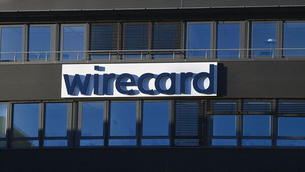 The logo of German payments provider Wirecard is seen at a building of the company's headquarters in Aschheim near Munich, southern Germany, on November 18, 2020 as the first creditors' event after the financial scandal takes place in Munich. - Sputnik International