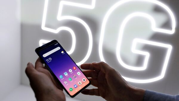 FILE PHOTO: Person checks out the new Xiaomi Mi 9 mobile phone ahead of the Mobile World Congress (MWC 19) in Barcelona - Sputnik International