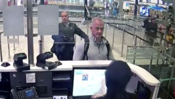 This Dec. 30, 2019 image from security camera video shows Michael L. Taylor, center, and George-Antoine Zayek at passport control at Istanbul Airport in Turkey. The U.S. State Department has agreed to turn over to Japan Taylor and his son Peter Taylor, who are accused of smuggling former Nissan Motor Co. Chairman Carlos Ghosn out of the country while he was awaiting trial, the men's lawyers said in legal filing on Thursday, Oct. 29, 2020 - Sputnik International