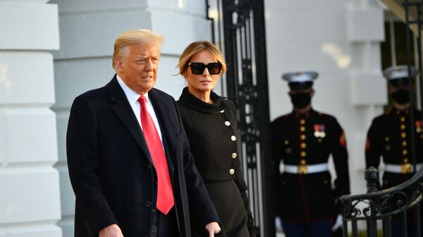 US President Donald Trump and First Lady Melania make their way to board Marine One before departing from the South Lawn of the White House in Washington, DC on January 20, 2021. - Sputnik International