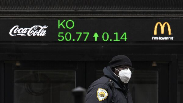 A security guard walks by a stock ticker displaying the cost of Coca-Cola shares at the New York Stock Exchange, Tuesday, Feb. 23, 2021. - Sputnik International