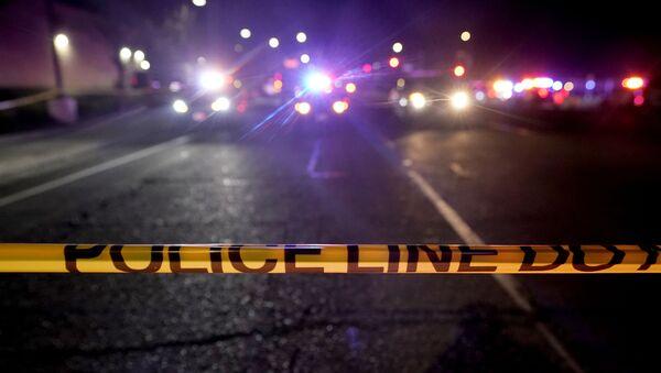 A police tape blocks a road near the scene where a Sacramento County Sheriff's deputy was shot and a suspect was shot and killed in the Sacramento suburb of Carmichael, Calif., Friday, Jan. 15, 2021. - Sputnik International