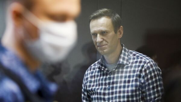 Russian opposition politician Alexei Navalny attends a hearing to consider an appeal against an earlier court decision to change his suspended sentence to a real prison term, in Moscow, Russia February 20, 2021. - Sputnik International