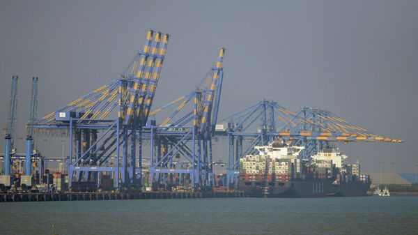 This photo taken on December 21, 2016 shows a container ship (R) docked at India's Adani Port Special Economic Zone (APSEZ) in Mundra - Sputnik International