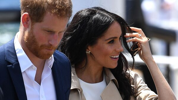 (FILES) In this file photo Britain's Prince Harry and wife Meghan arrive for a public walk at the Sydney Opera House in Sydney on October 16, 2018 - Sputnik International