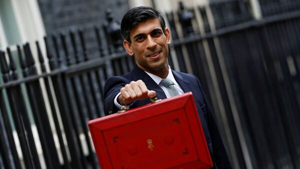 FILE PHOTO: Britain's Chancellor of the Exchequer Rishi Sunak holds the budget box outside his office in Downing Street in London - Sputnik International