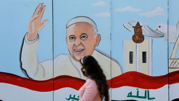 A mural of Pope Franci is seen on the wall of a church upon his upcoming visit to Iraq, in Baghdad. - Sputnik International