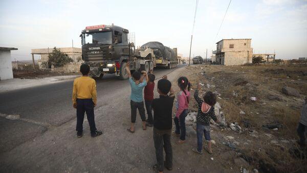 Turkish military convoy drives through the village of Urum al-Jawz, in Idlib province, Syria, Tuesday, Oct. 20, 2020.  - Sputnik International