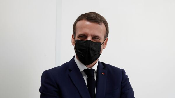 French President Emmanuel Macron, wearing a protective face mask, visits a coronavirus disease (COVID-19) vaccination center at the Caisse Primaire d'Assurance Maladie (France's local health insurance funds - CPAM) in Bobigny near Paris as part of the COVID-19 vaccination campaign in France, March 1, 2021. - Sputnik International