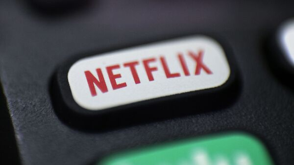 Logo for Netflix on a remote control  - Sputnik International