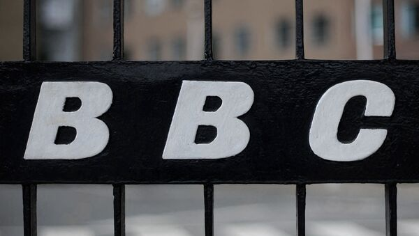 A view of a BBC logo on a gate near the entrance to the BBC Television offices in west London, on October 6, 2011.  - Sputnik International