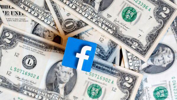 A 3-D printed Facebook logo is seen on U.S. dollar banknotes in this illustration picture, June 18, 2019.  - Sputnik International