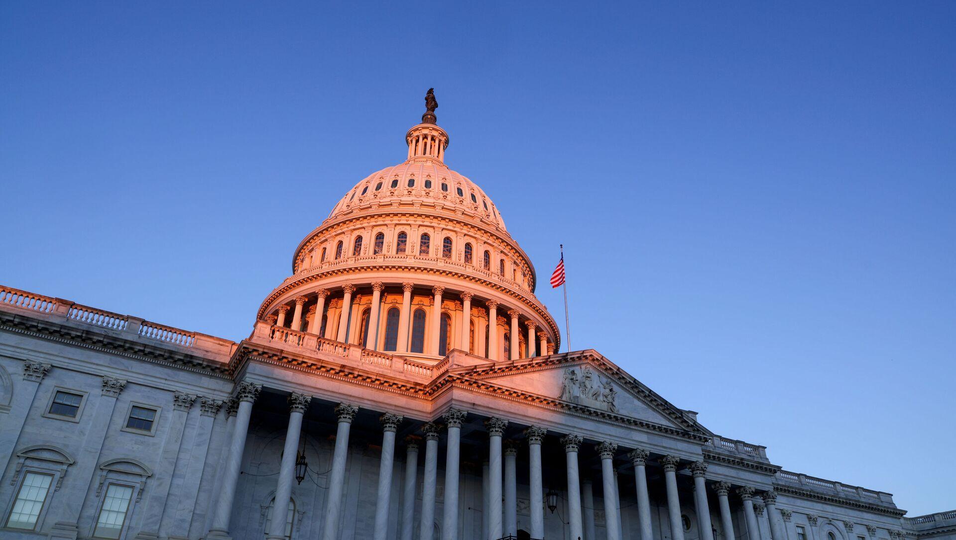 The sun rises on the U.S. Capitol dome before Joe Biden's presidential inauguration in Washington, U.S., January 20, 2021.  - Sputnik International, 1920, 28.07.2021