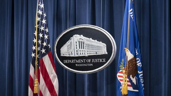 A sign for the Department of Justice is seen ahead of a news conference Tuesday, Jan. 12, 2021, in Washington.  - Sputnik International