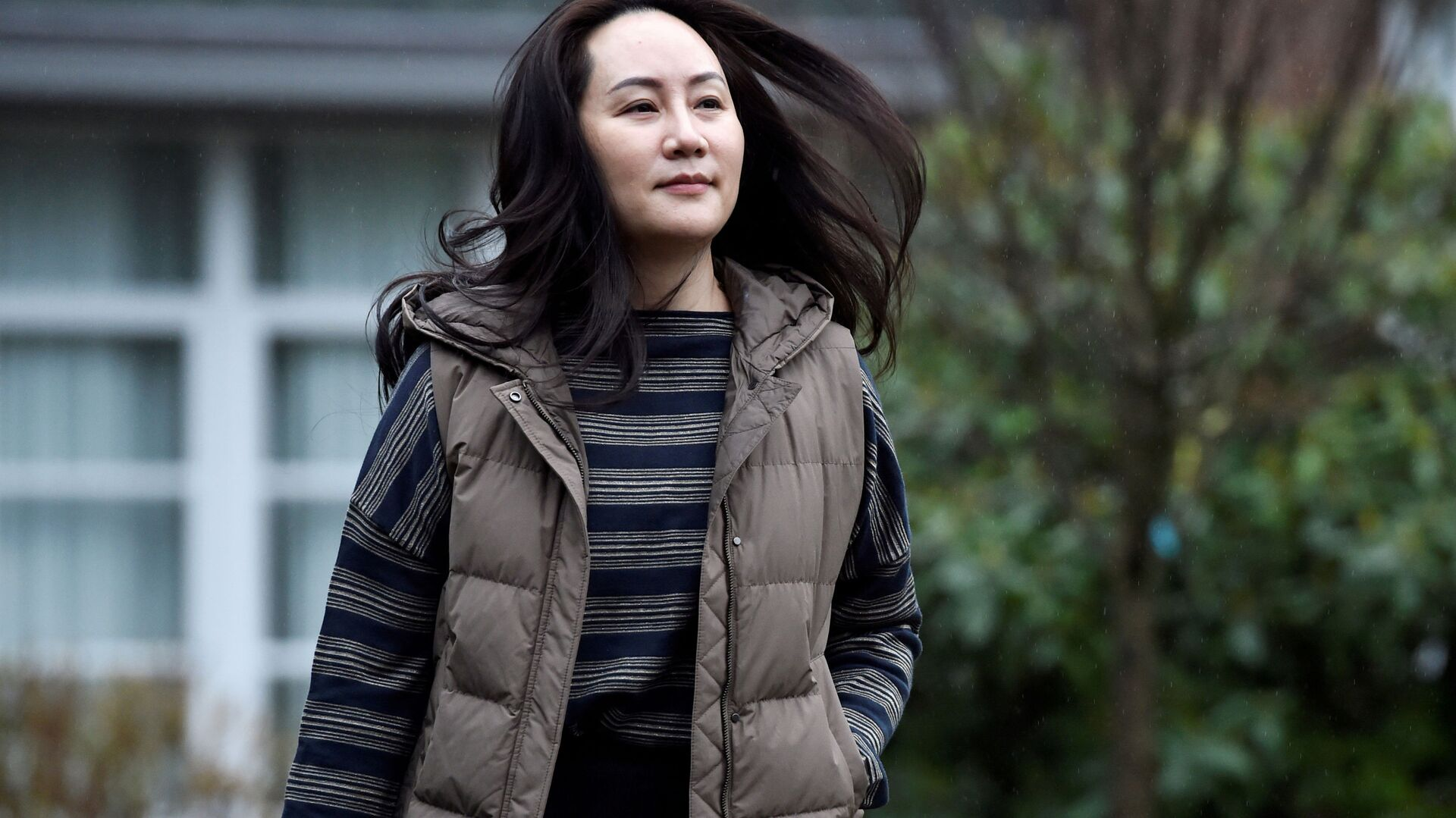 Huawei Technologies Chief Financial Officer Meng Wanzhou leaves her home to attend a court hearing in Vancouver, British Columbia, Canada December 7, 2020. - Sputnik International, 1920, 24.09.2021