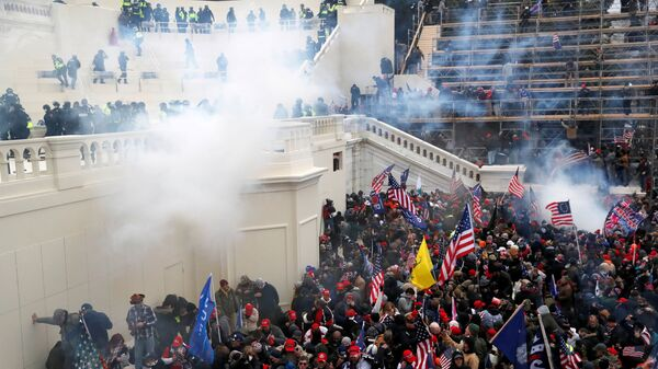 A mob of supporters of former U.S. President Donald Trump fight with members of law enforcement at a door they broke open as they storm the U.S. Capitol Building in Washington, U.S., January 6, 2021 - Sputnik International