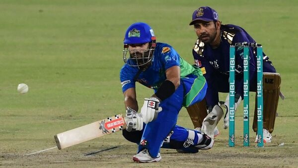 Multan Sultans' Mohammad Rizwan (L) plays a shot during the Pakistan Super League (PSL) T20 cricket match between Quetta Gladiators and Multan Sultans at the National Stadium in Karachi on March 3, 2021 - Sputnik International