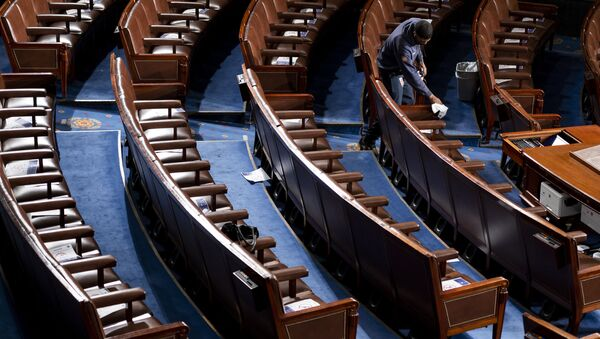 A Capitol worker cleans the House floor on opening day of the 117th Congress at the U.S. Capitol in Washington, Sunday, Jan. 3, 2021 - Sputnik International
