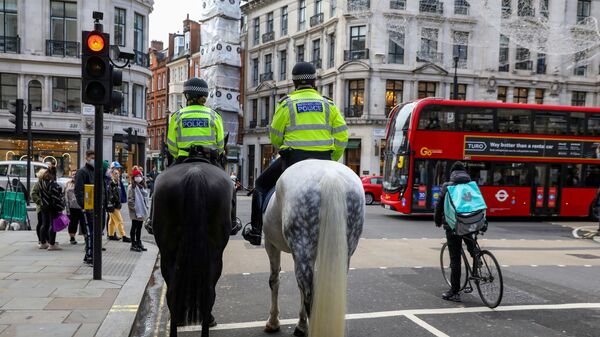 FILE PHOTO: Mounted police and a Deliveroo rider wait at a red light at Regent Street, one of London's main shopping streets, a day after a new lockdown was announced during the coronavirus disease (COVID-19) outbreak in London, Britain November 1, 2020 - Sputnik International