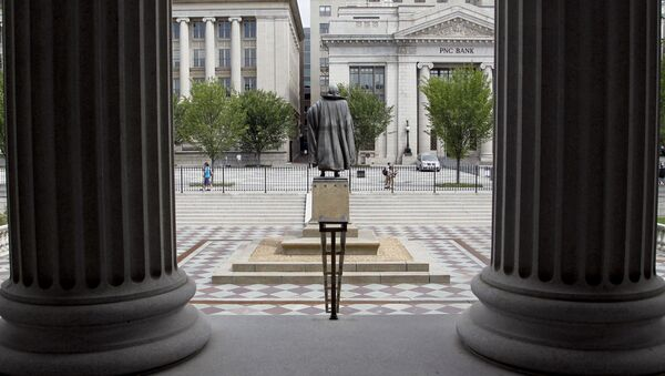 In this Aug. 17, 2010 file photo, a statue of the Albert Gallatin, the 4th Secretary of the Treasury, stands on the north patio of the US Treasury Building in Washington - Sputnik International