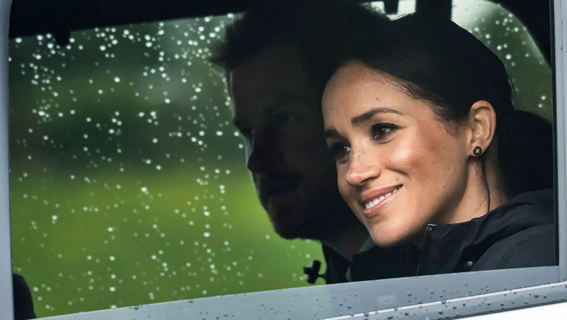 (FILES) In this file photo Britain's Prince Harry and his wife Meghan, Duchess of Sussex arrive for the unveiling of a plaque dedicating 20 hectares of native bush to the Queen's Commonwealth Canopy project at The North Shore Riding Club in Auckland on October 30, 2018 - Sputnik International, 1920, 26.05.2021