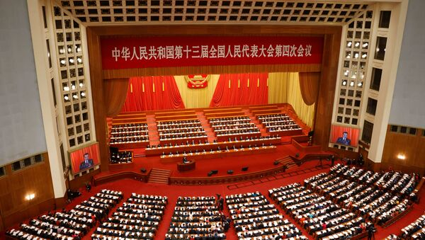 Chinese Premier Li Keqiang speaks at the opening session of the National People's Congress (NPC) at the Great Hall of the People in Beijing, China March 5, 2021. - Sputnik International