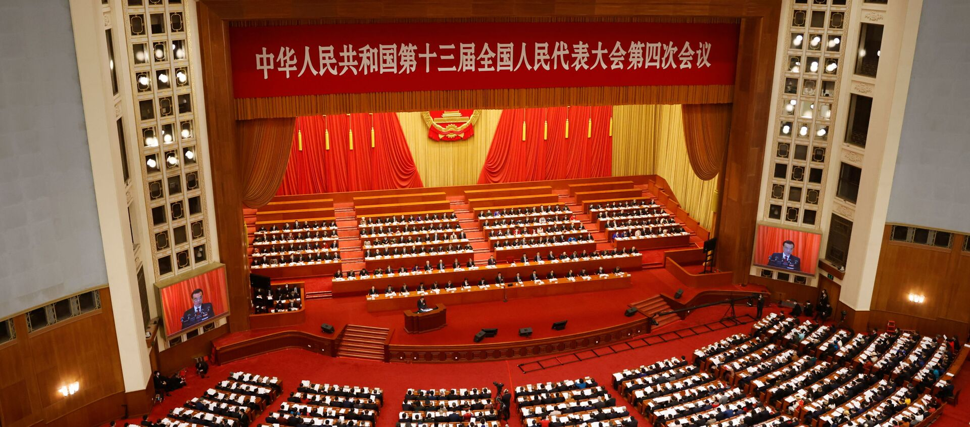 Chinese Premier Li Keqiang speaks at the opening session of the National People's Congress (NPC) at the Great Hall of the People in Beijing, China March 5, 2021. - Sputnik International, 1920, 13.08.2021